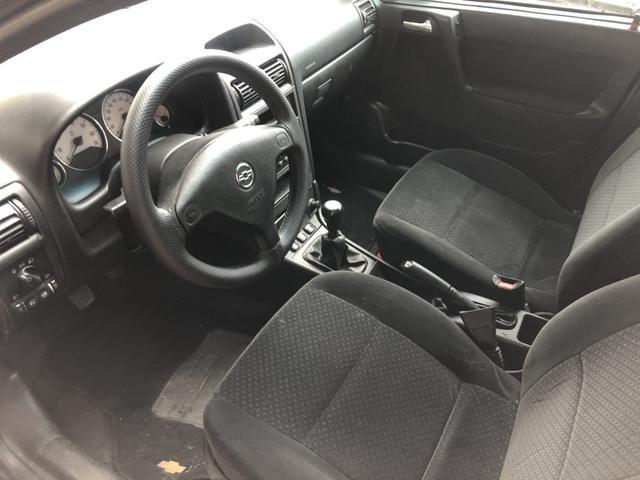 Astra Sedan 2010 - Foto 8