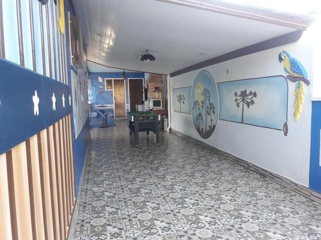 Casa com Piscina Confortável em Ótima Localização - Foto 11