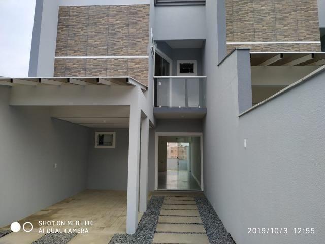 Sobrado geminado com 107 m² no Bairro Iririu - Foto 2