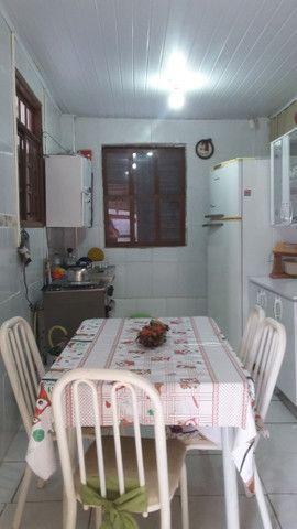 Vendo ou permuto ótima casa a uma quadra do mar - Foto 7