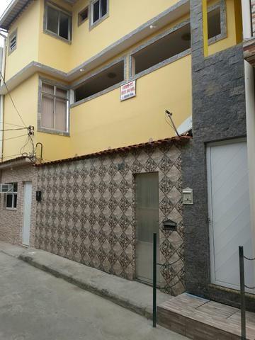 Vende - se um prédio composto por 5 casas