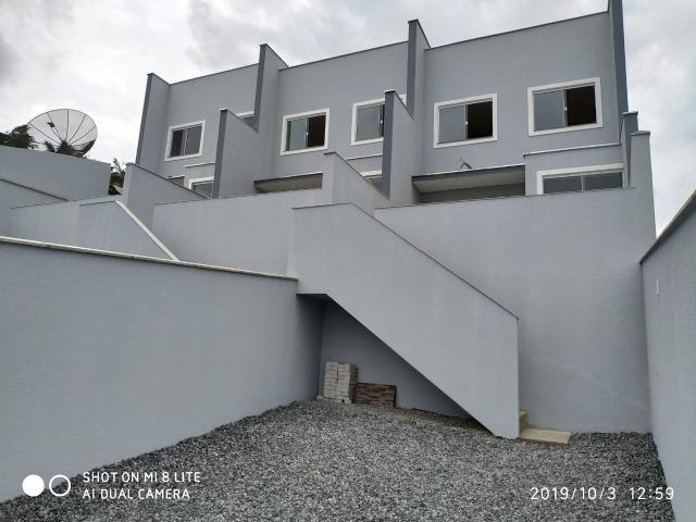 Sobrado geminado com 107 m² no Bairro Iririu - Foto 13