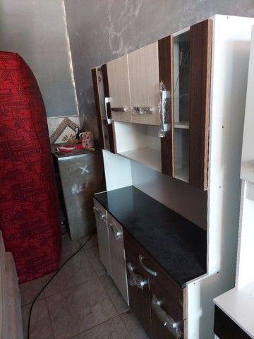 Vendo armário de cozinha novo com avarias como mostra na foto.