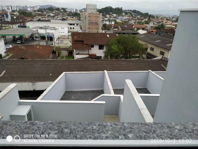 Sobrado geminado com 107 m² no Bairro Iririu - Foto 14