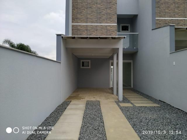 Sobrado geminado com 107 m² no Bairro Iririu - Foto 3