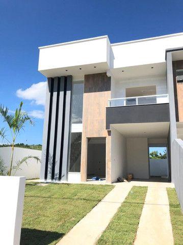 (TH1007) Duplex com 2 suítes e garagem semi coberta no bairro Forquilhas em São José!!!