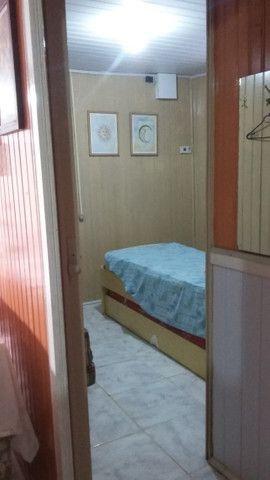 Vendo ou permuto ótima casa a uma quadra do mar - Foto 4