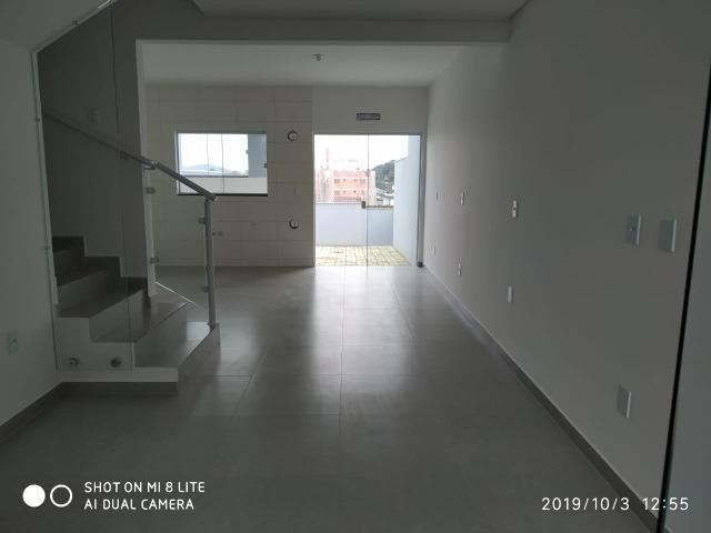 Sobrado geminado com 107 m² no Bairro Iririu - Foto 5