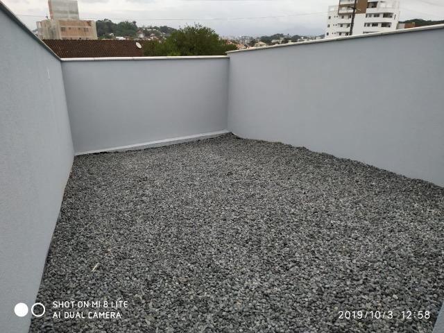 Sobrado geminado com 107 m² no Bairro Iririu - Foto 15