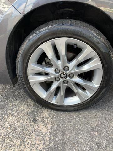 Toyota Corolla Xei cinza aut 2018 27.000km - Foto 6
