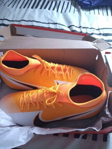 Chuteira Campo Nike Mercurial Superfly 7 Club FG - Laranja+Preto<br>