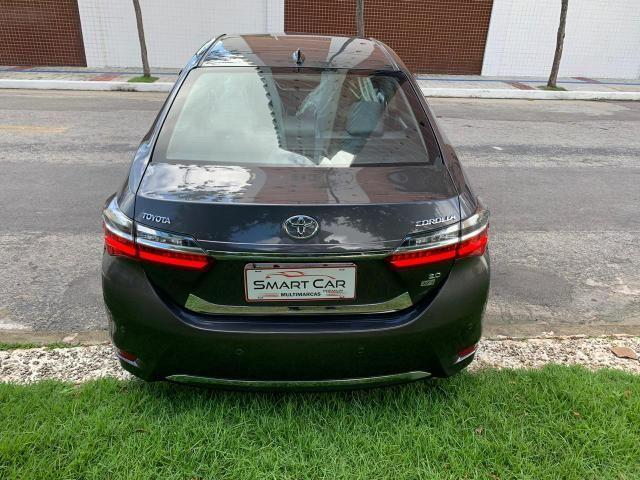 Toyota Corolla Xei cinza aut 2018 27.000km - Foto 4