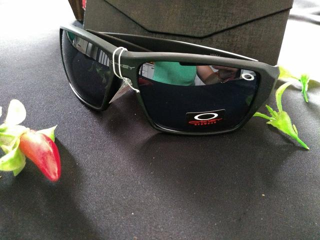 Óculos de Sol Oakley Masculino Primeira Linha - Bijouterias ... 97f9233a18