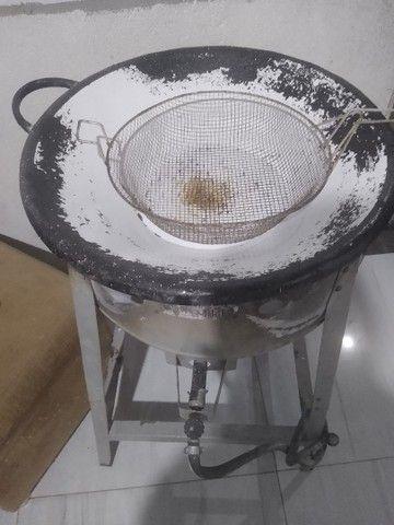 Tacho de batata frita e processador de suco