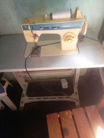 Vendo uma maquina de costura singer por 450 ou pego um celular