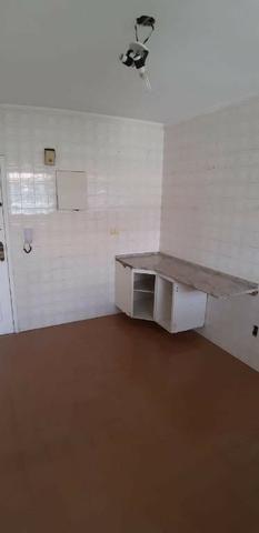 Aparecida - 2 dormitórios, sala 2 ambientes, área de serviço e garagem - Foto 9