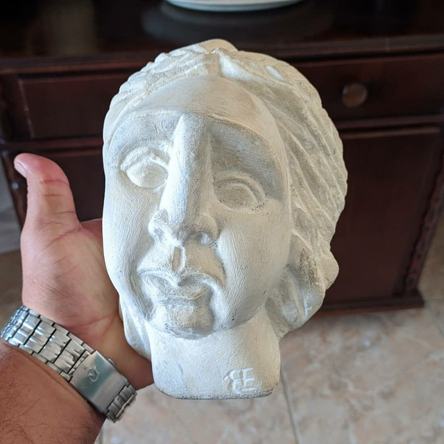 Escultura em pedra calcária