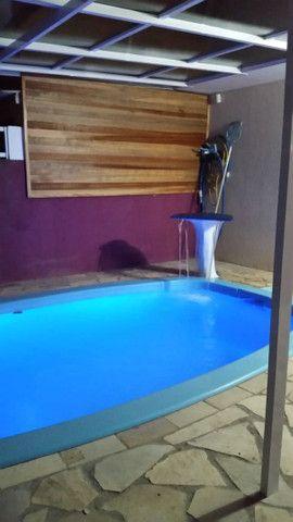 Casa com piscina muito aconchegante.