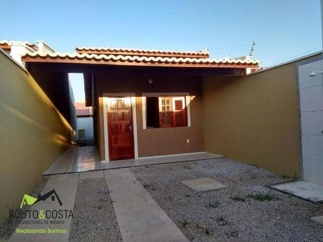 Casa com garagem para 2 carros, quintal, corredor lateral área de serviço, sala