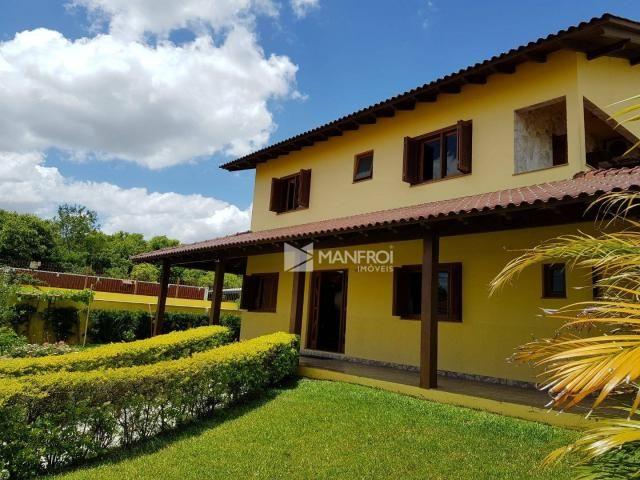 Casa com 5 dormitórios à venda, 509 m² por R$ 1.299.990,00 - Rubem Berta - Porto Alegre/RS