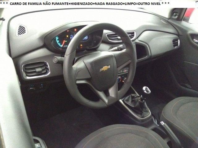 Chevrolet Onix 2013 1.4flex completo ar condicionado laudo aprovado baixa km - Foto 3