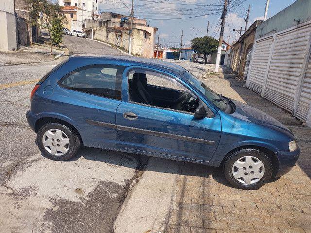 GM  Celta 1.0 VHC (  ano 2003 ).apenas  112.000 km  com  Direção Hidráulica e alarme   - Foto 4