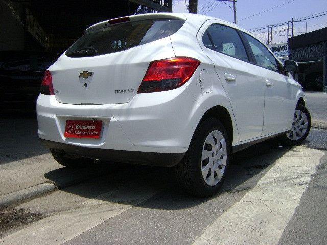 Chevrolet Onix 2013 1.4flex completo ar condicionado laudo aprovado baixa km - Foto 5