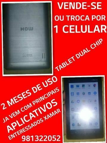 Troco Tablet Semi novo em Celular.