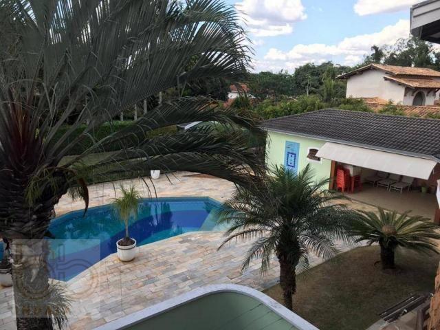 Casa com 4 dormitórios para alugar, 578 m² por R$ 12.000,00/mês - Condomínio Helvetia Coun - Foto 15