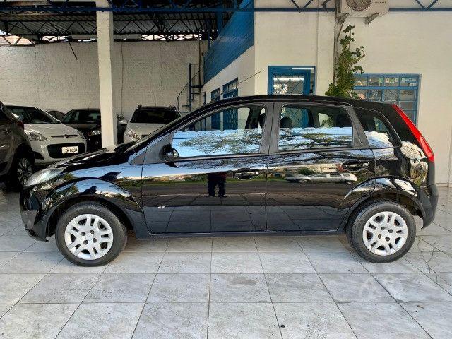 Ford Fiesta 1.0 8v 2014 único dono com ABS + Air bag duplo - Foto 4