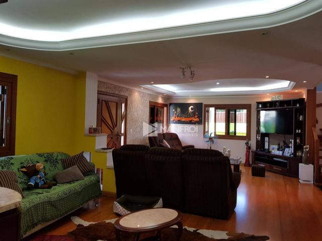 Casa com 5 dormitórios à venda, 509 m² por R$ 1.299.990,00 - Rubem Berta - Porto Alegre/RS - Foto 5