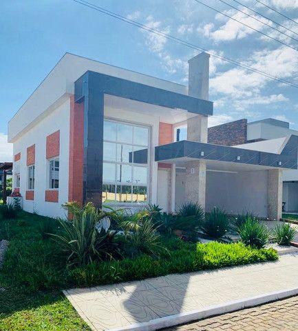 Linda casa em condomínio fechado a poucos minutos do centro de Torres  - Foto 2