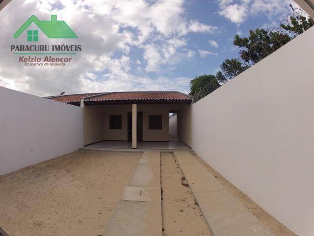 Ampla casa nova de três quartos financiada em Paracuru - Foto 2