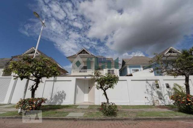 Casa de condomínio à venda com 4 dormitórios cod:FLCN40064