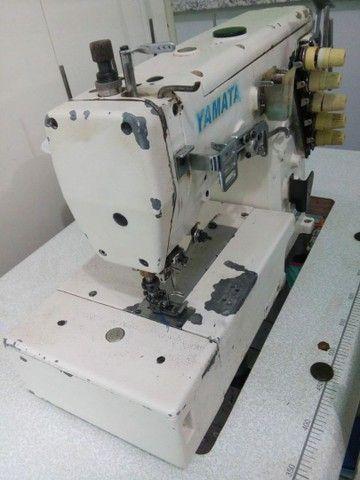 Máquina costura cobertura