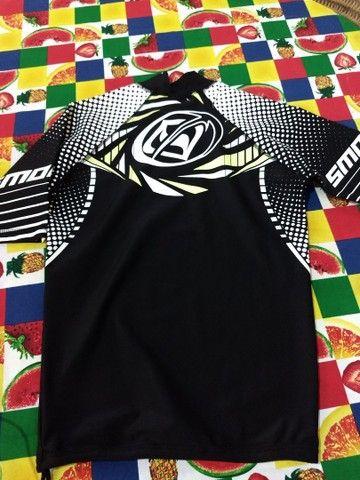 """Camisas Lycra """"Original"""" Smolder"""