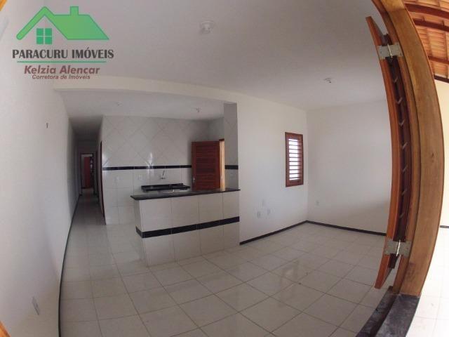 Ampla casa nova de três quartos financiada em Paracuru - Foto 4