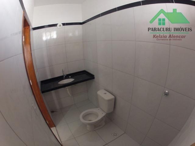 Ampla casa nova de três quartos financiada em Paracuru - Foto 11