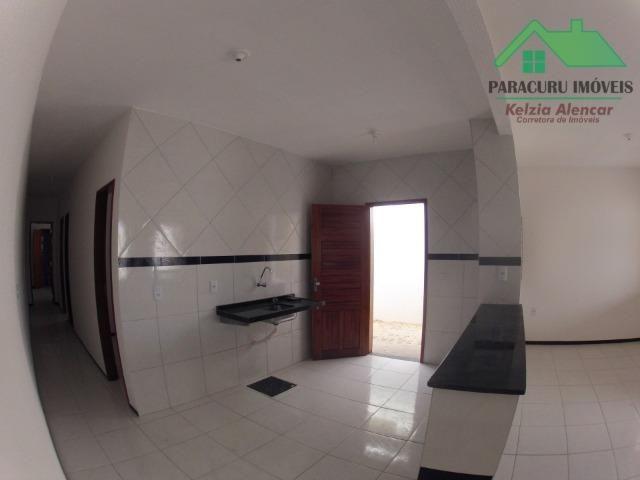 Ampla casa nova de três quartos financiada em Paracuru - Foto 6