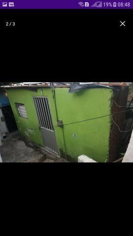 Vende duas casas com um terreno - Foto 2