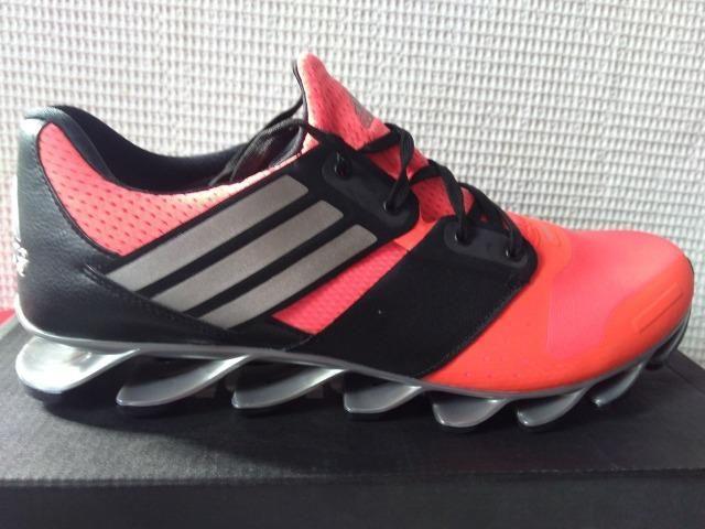 competitive price 8468e 75544 Tênis Adidas Springblade Solyce - Laranja e Preto Original