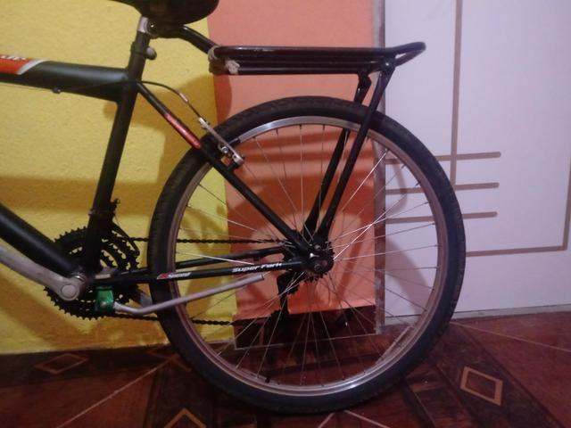 Vendo uma bicicleta semi-nova da Caloi 200 - Foto 6