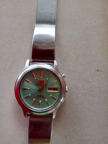 Relógio masculino Orient três estrelas top demais