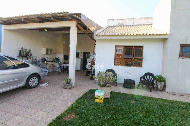 Casa à venda com 3 dormitórios 3 banheiros 2 vagas de garagem e amplo pátio. - Foto 6