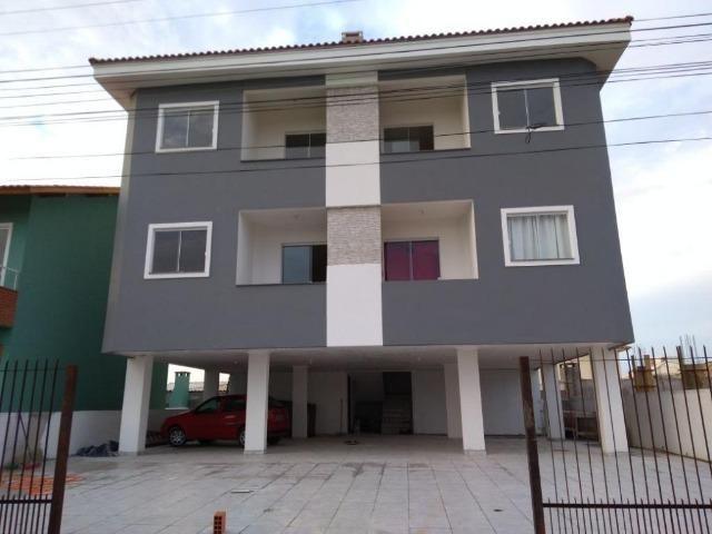 MC-AP0356 Apartamento de 2 dormitórios frente com sacada e churrasqueira