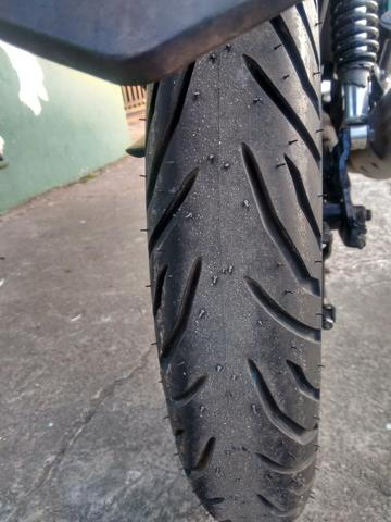 Vendo ou troco pneu pirelli super city 100/90-18