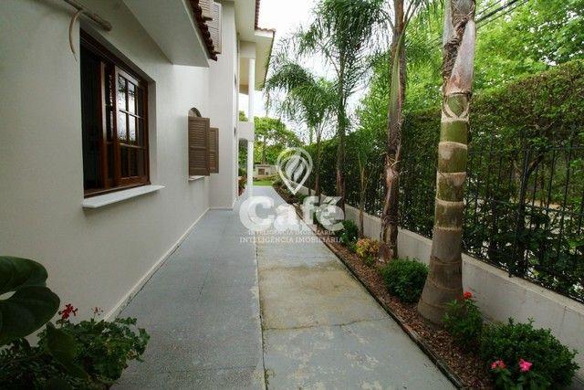 Casa de esquina para Venda, Bairro Camobi, 4 dormitórios. - Foto 4