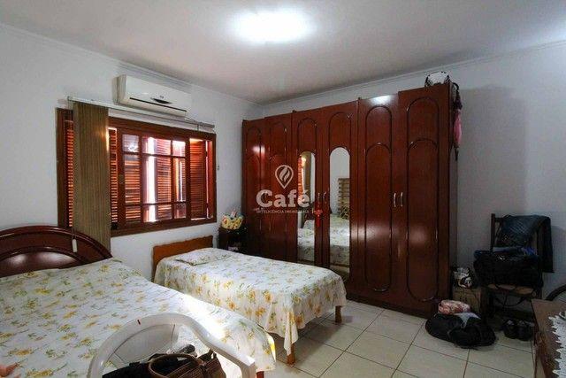 Casa à venda com 3 dormitórios 3 banheiros 2 vagas de garagem e amplo pátio. - Foto 13