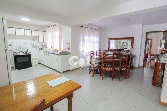 Casa de esquina para Venda, Bairro Camobi, 4 dormitórios. - Foto 13