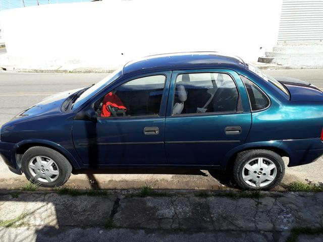 corsa sedan 99 ar trava alarme som - 1999